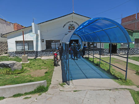 Getting my passport stamped out of Bolivia in the border town of Kasani.