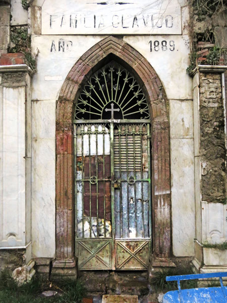 A distressed, weathered door to a crypt in the Cementerio General in La Paz, Bolivia.