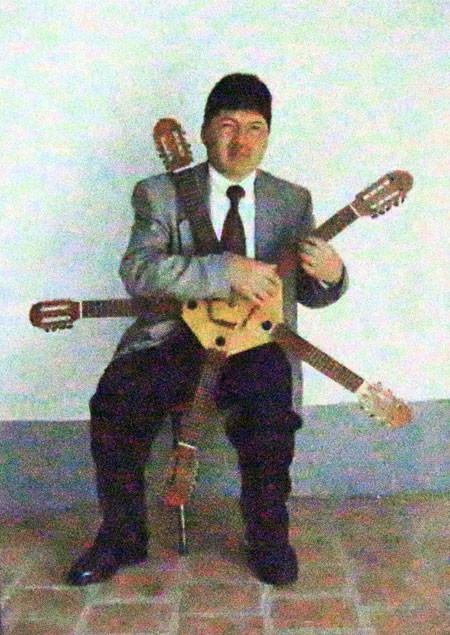 A zoomed in photo of a photo of a star-shaped charango with five necks at the Museo de Instrumentos Musicales in La Paz, Bolivia.