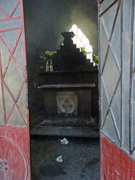 A shrine inside the base of the Cristo del Sagrado Corazón on the summit of Cerro Churuquella in Sucre, Bolivia.