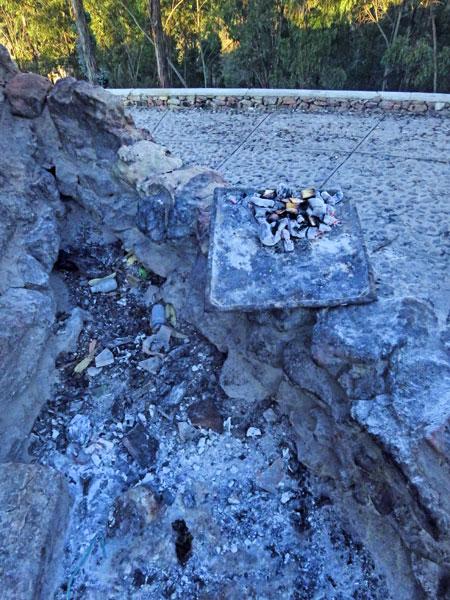 Burnt offerings on the base of the Cristo del Sagrado Corazón on the summit of Cerro Churuquella in Sucre, Bolivia.