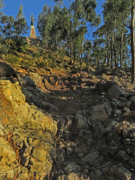 The rocky path leading up to the Cristo del Sagrado Corazón on the summit of Cerro Churuquella in Sucre, Bolivia.