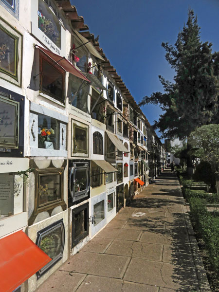 A wall of caskets with awnings at the Cementario General in Sucre, Bolivia.