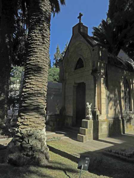 A palm tree and a crypt at the Cementario General in Sucre, Bolivia.