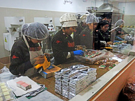 Employees pack up chocolate at the Choco Museo in Cuzco, Peru.