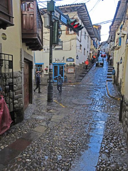 A rain-soaked cobblestone back lane in Cuzco, Peru.