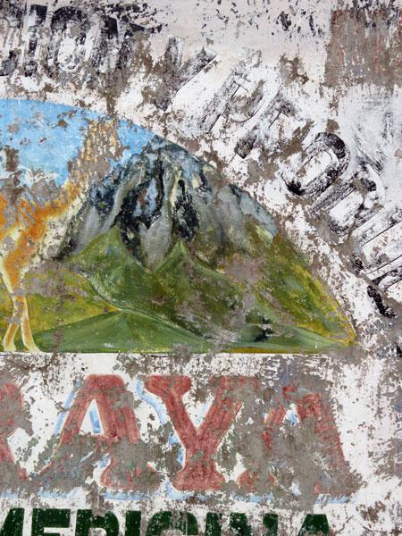 A close-up of a weathered sign in Laraya, Peru.