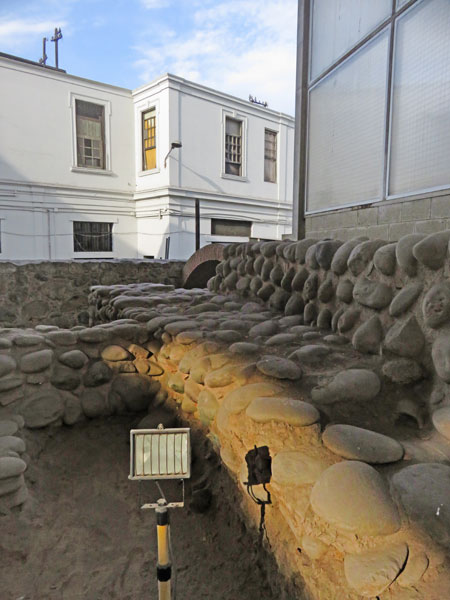 Stone ruins in the Museo de Sitio Bodega y Qvadra in Lima, Peru.