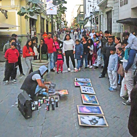 A spray paint artist who later got kicked out by the police in Lima, Peru.