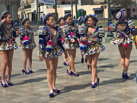 Caporales dancers on Avenida Paseo de la Republica in Lima, Peru.