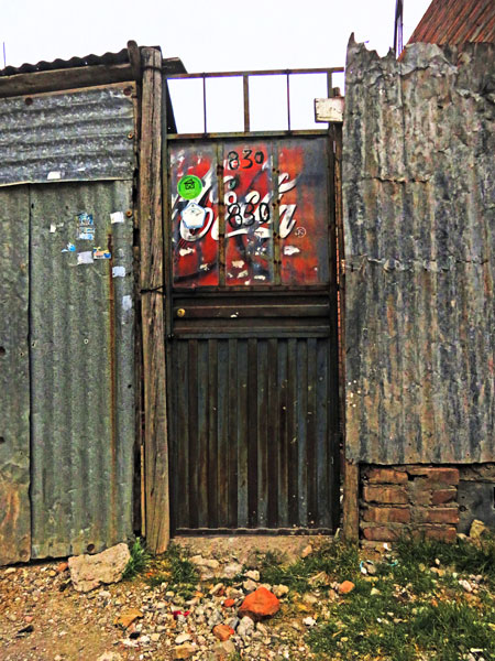 A corrugated metal door and wall in Puno, Peru.