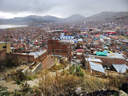 A rainy day overview of Puno, Peru.