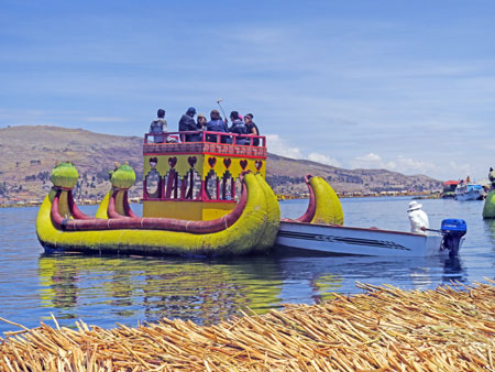 A dragon boat made out of totora reeds that shuttles tourists around the Uros Islands near Puno, Peru.