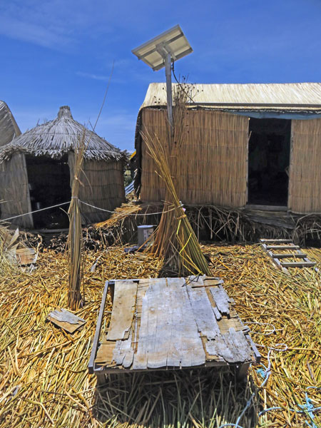 Huts made out of totora reeds on the Uros Islands near Puno, Peru.