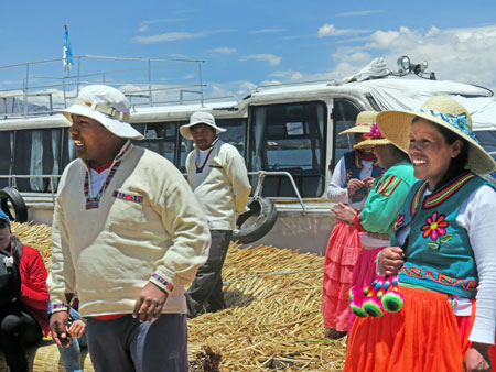Locals perform for tourists on the Uros Islands near Puno, Peru.