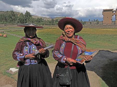Two women sell magazines at Raqchi in San Pedro, Peru.