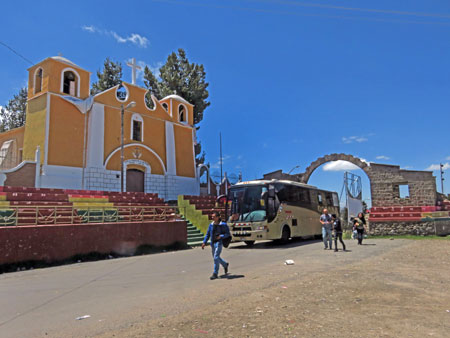 A Catholic church and an arch in Kasani at the border between Bolivia and Peru.
