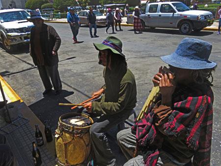 Street musicians jam in Yunguyo, Peru.
