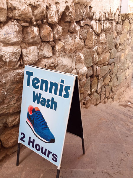 Get your tennis washed in two hours in Cuzco, Peru.