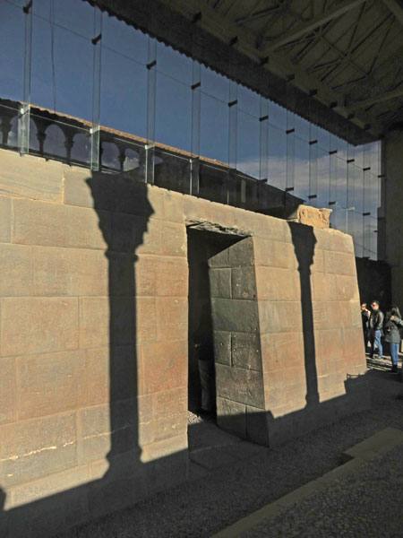Sunset shadows play on the ruins of an Inca temple at Qorikancha in Cuzco, Peru.