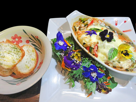 Vegetarian lasagna with edible flowers in Cuzco, Peru.
