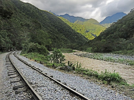 Train tracks run through a beautiful valley in between Hidroelectrica and Aguas Calientes, Peru.
