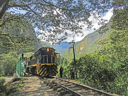 A Peru Rail train crosses a bridge between Aguas Calientes and Hidroelectrica, Peru.