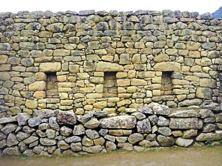 A stone wall built by the Incas at Machu Picchu, Peru.